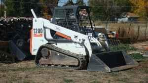 03 Bobcat T-200 with 709 Backhoe - $24500 (Grand