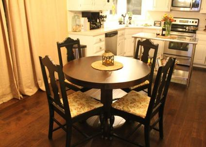 $100 Dark brown oval-shaped table sits 4 comfortbaly