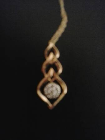 10K Gold necklace and diamond pendant - $325