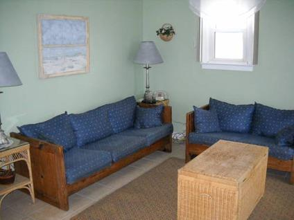 $125 Solid Oak Sofa with Wedgewood Blue Pattern