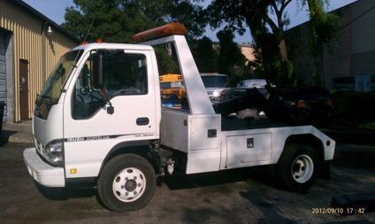 $13,000, 2007 Isuzu NPR Century 301 Self Loader Tow truck Wrecker
