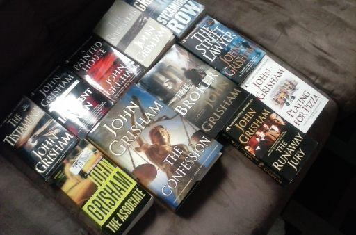 $130 VALUE FOR $60 OF BOOKS WRITTEN BY JOHN GRISHAM