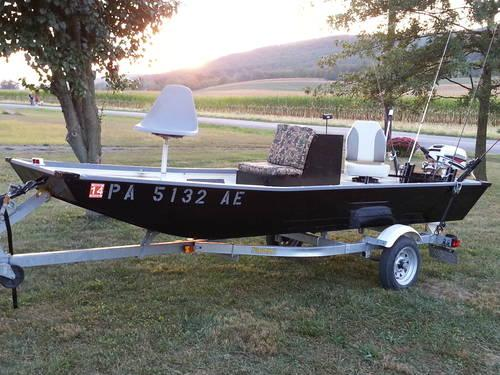 14 ft jon boat/trailor/15 hp electric start motor & xtras