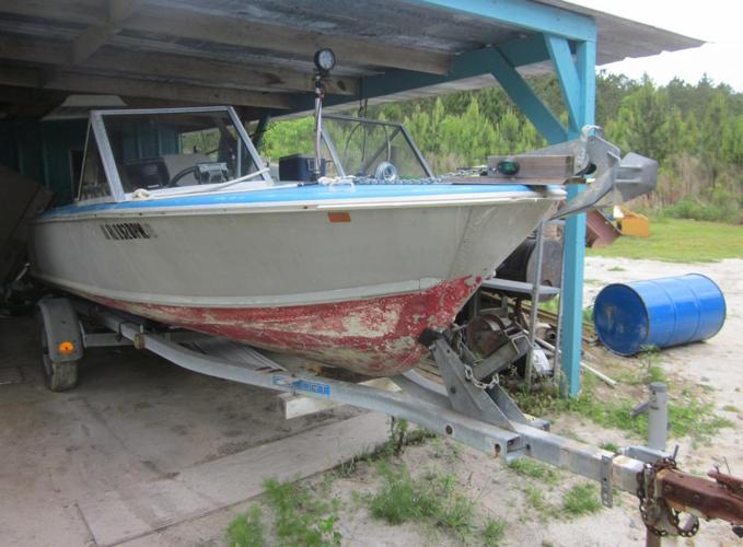 17 ft Aluminum boat, motor, and trailer