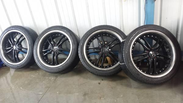 19 inch black and chrome avarus staggered tires and
