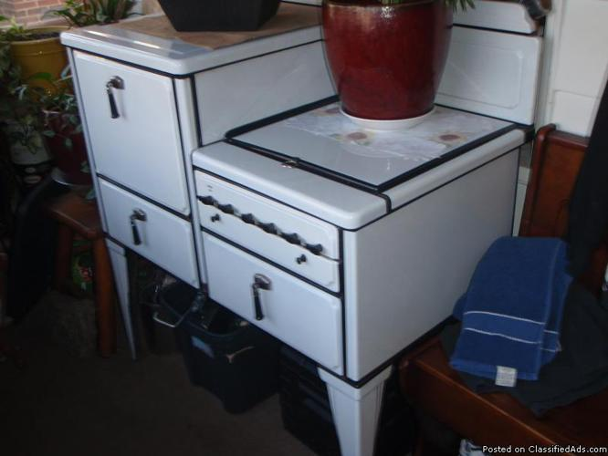 1920 vintage porcelain gas stove with 4 burners and an oven and a storage drawer