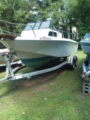 1989 Galaxy 23ft walk around fishing boat cuddy wtrailer .