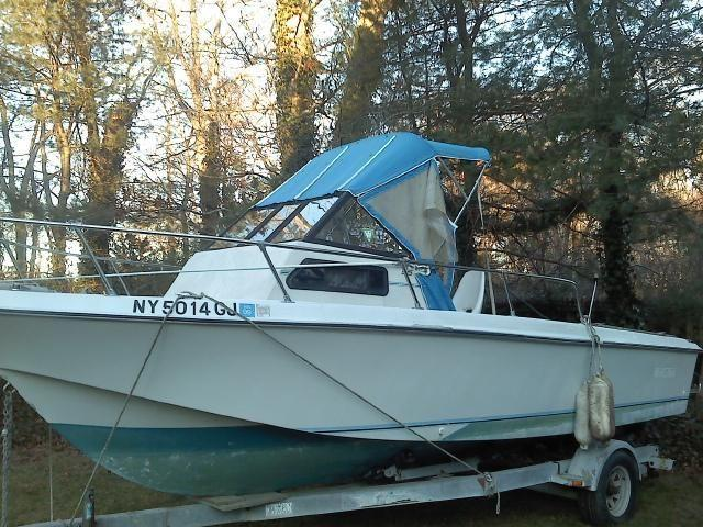 1989 Galaxy 23ft walk around fishing boat cuddy wtrailer .Trades