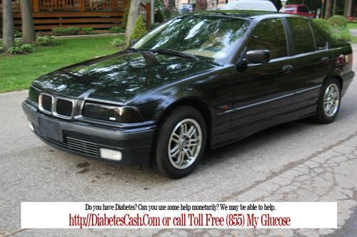 1996 BMW 328i , Auto, 4 door, eather,power everything.Black on Saddle