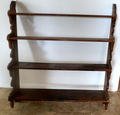 19th century handmade graduated walnut wall shelf