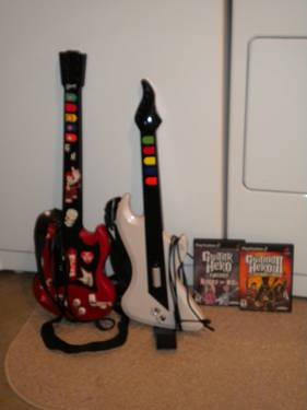 2) PS2 Guitar Hero guitars and two games