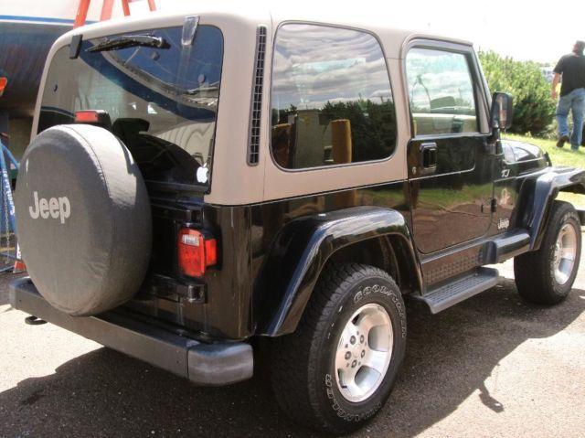 2002 jeep wrangler tj sahara 6cyl black auto 16k mi for sale in minneapolis minnesota. Black Bedroom Furniture Sets. Home Design Ideas