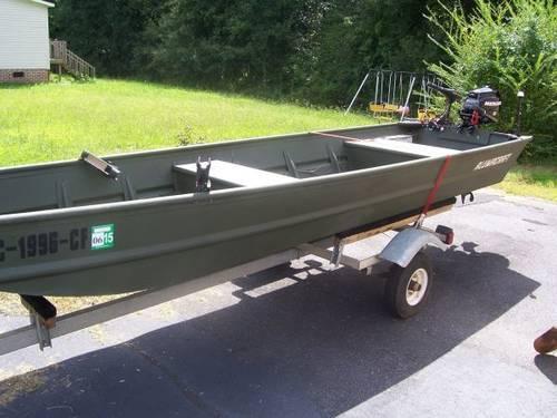 2010 14' Alumacraft Jon Boat w/trailer,motor,and trolling motor