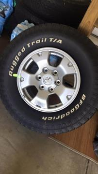 2015 4x stock rims and tires brand new -