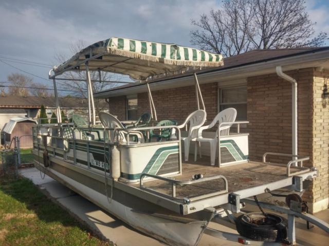 24 ft party pontoon w/ 70 HP