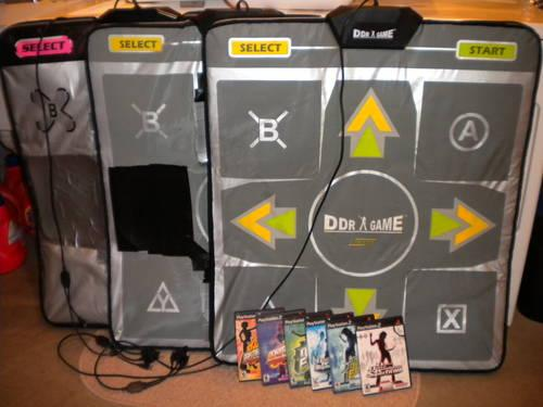 3) PS2 DDR Deluxe foam mats and six games