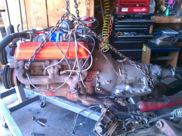 327 Chevy engine+ 350 trans, Double hump heads - $1000