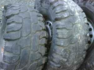 33-12.50-15 super swamper tires n rims - $100