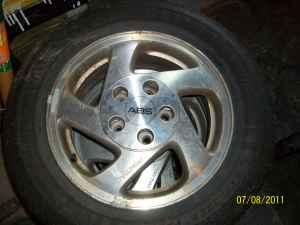 (4) 215/60/15 tires on aluminum rims - $300 (trilla)