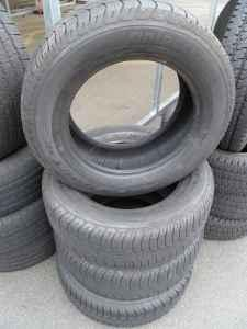 4 bridgestone dueler h/t p235 60 r16 tires - $300