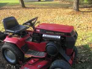 416-H Wheel Horse w/Snow blower,tire chains plow and