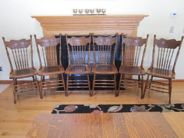 Matching antique oak pressed back chairs for sale in