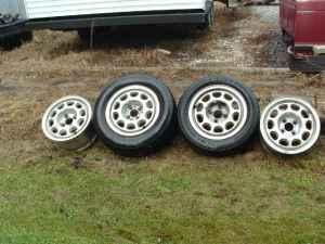 79-93 FORD MUSTANG 4 LUG 10 HOLE OEM ALLOY WHEELS SET OF 4 GOOD COND   (Southern Indiana)