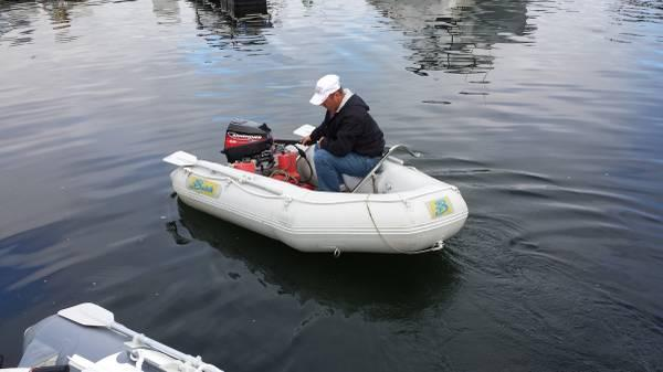 8 39 6 inflatable boat motor and davit for sale in for Dinghy motor for sale