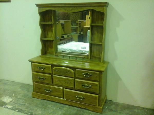 8 Drawer Dresser with Mirrored Hutch for Sale in Broken