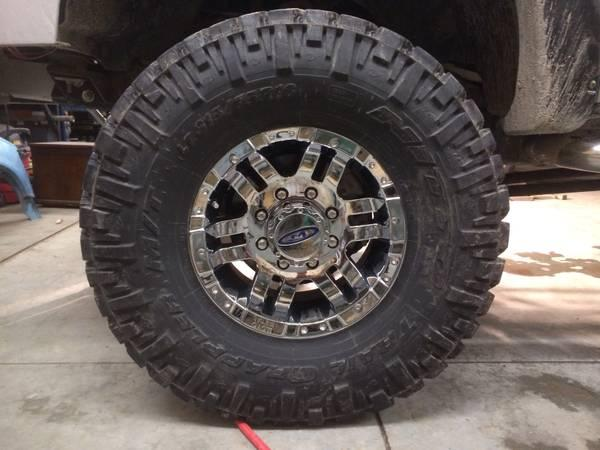8 lug moto metal wheels and 35in nittos - $2400