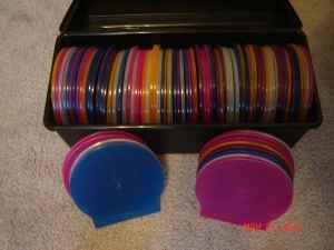 80+ color cd flex cases plus plastic box - $15