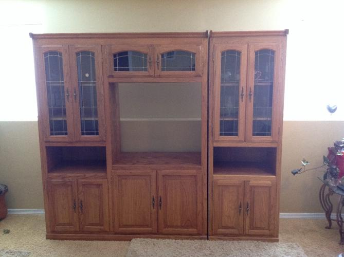 A beautiful, must see, soiled oak entertainment center