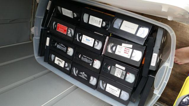 alot of vhs tapes and 5 or 6 dvds and a vhs rewinder