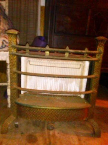 antique cast iron gas heater, nice condition 100 obo