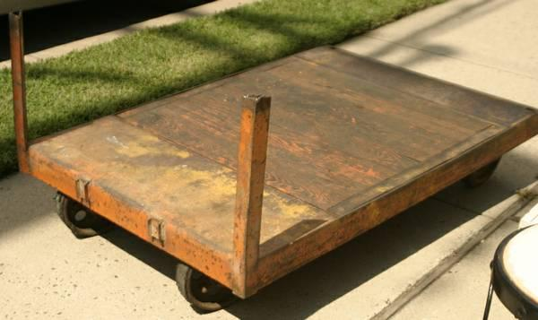 antique painted orange industrial wagon cart on wheels