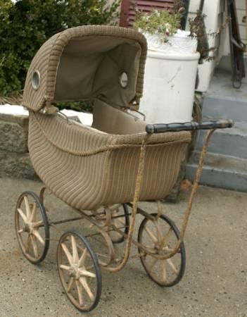 antique Victorian wicker baby carriage with side lights
