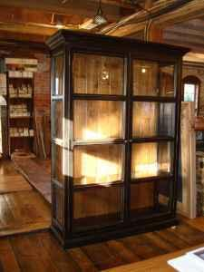 antique wood custom made black bookcase w glass doors.