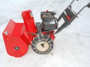 ARIENS ST824 SNOWBLOWER with tire chains & electric