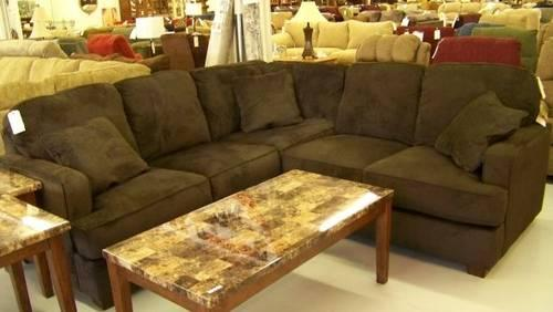 https://images1.americanlisted.com/nlarge/ashley-furniture-atmore-chocolate-sectional-laporte-in-americanlisted_29878833.jpg