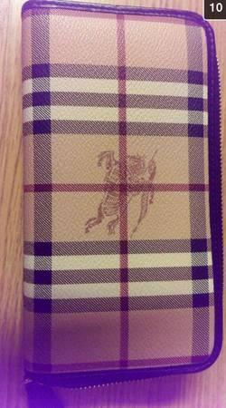 Authentic- Burberry zip wallet - $250