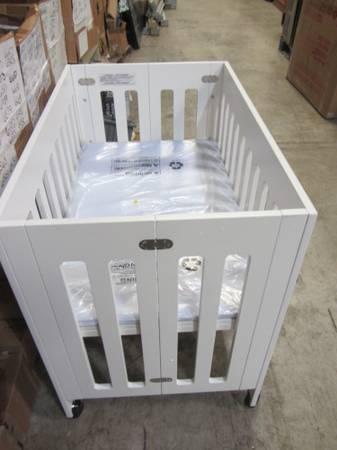 babyletto Grayson Mini Crib with Mattress Pad for Sale