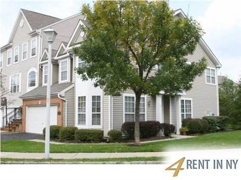 Beautiful 4 Bedroom Townhouse with 2 car garage.