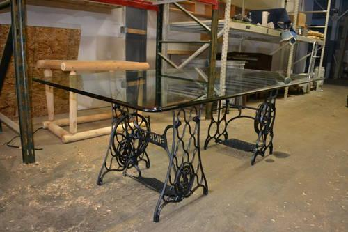 Beautiful 80x46 Glass Table Supported By Antique Sewing
