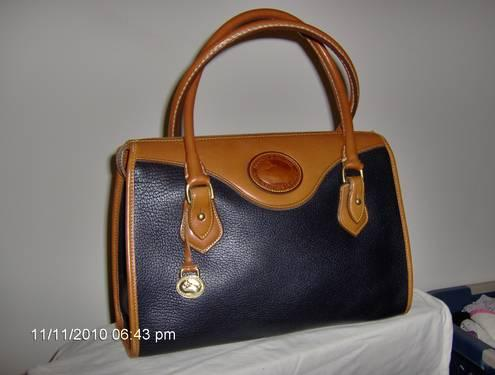 Beautiful and lightly used Dooney and Bourke bag and wallet