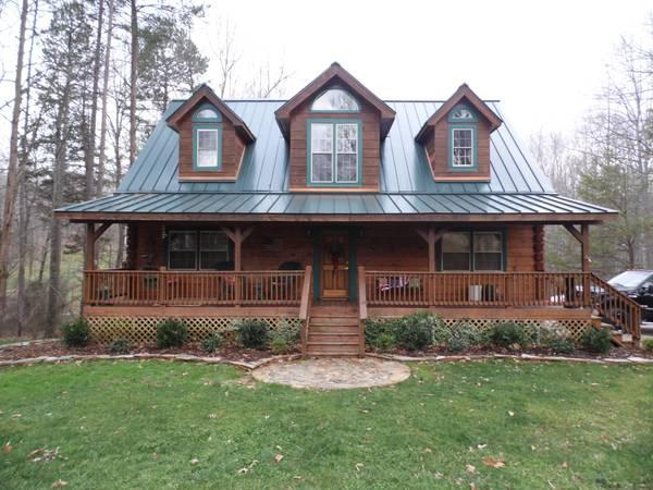 Beautiful log homes custom made credit challenged ok for Cabins with metal roofs