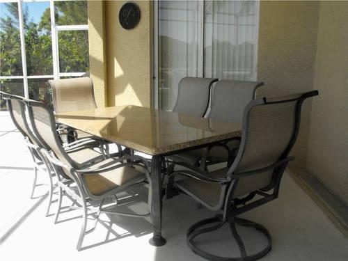Beautiful Solid Granite Top Patio Table With 6 Chairs And