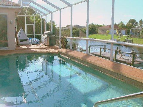 beautiful south gulf cove pool home with boat dock for