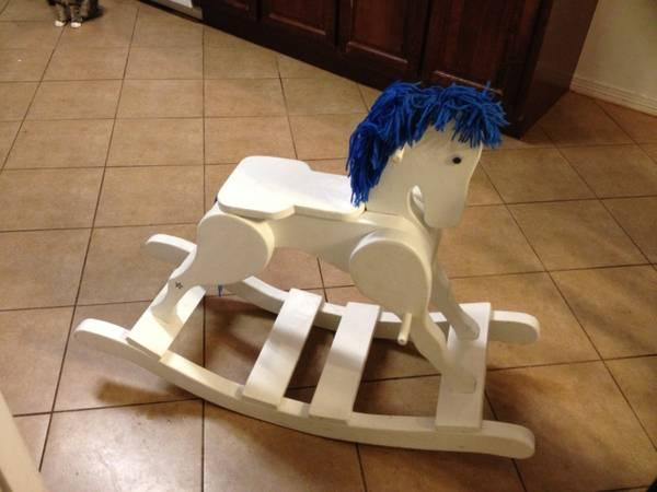 Beautiful wooden rocking horse - $100