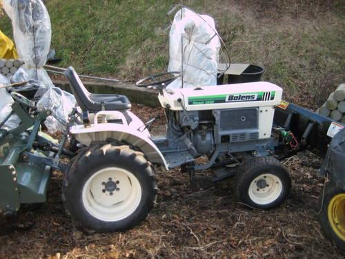 BEAUTIFULL BOLESN DIESEL TRACTOR WITH 4-WAY PLOW,NEW REAR