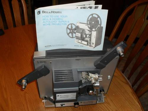 Bell  Howell 8mm movie projector,splicer,and portable tripod screen